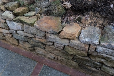 Dry-Laid and Wet-Laid Stone Wall Varieties
